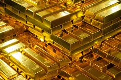 stock image of  fine gold bars in bank vault
