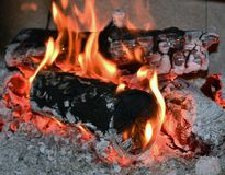 stock image of  fire flame, burning wood at the fireplace. firewood log in the fire chimney, closeup