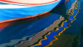 stock image of  fishing boat with reflection,legendary and iconic colorful,colorful reflection of fishing boats in malta