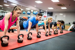 stock image of  fit people working out in fitness class