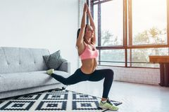 stock image of  fit woman doing front forward one leg step lunge exercises workout
