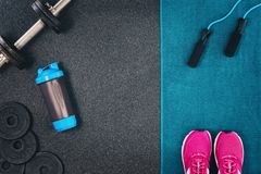 stock image of  fitness or bodybuilding background. dumbbells on gym floor, top view
