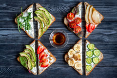 stock image of  fitness breskfast with homemade sandwiches dark table background top view