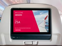 stock image of  in-flight entertainment screen, inflight screen, seatback screen in airplane