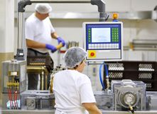 stock image of  food industry - biscuit production in a factory on a conveyor be