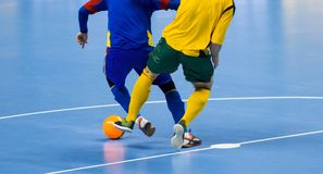 stock image of  football futsal ball and man team. indoor soccer sports hall.