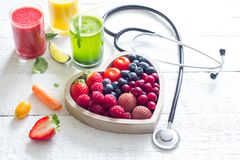 stock image of  fresh fruits vegetables and heart shape with stethoscope health diet concept
