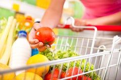stock image of  full shopping cart at supermarket