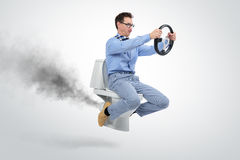 stock image of  funny businessman flying on the toilet