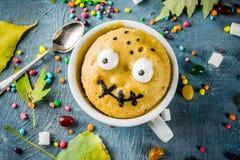stock image of  funny mug cake for halloween