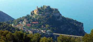 stock image of  eze village french riviera, côte d`azur, mediterranean coast, eze, saint-tropez, cannes and monaco. blue water and luxury yachts.