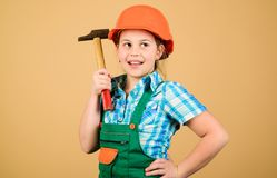 stock image of  future profession. child care development. builder engineer architect. kid worker in hard hat. tools to improve yourself