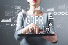 stock image of  gdpr with woman using a tablet