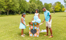 stock image of  gender reveal, expecting mother to two children