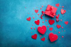 stock image of  gift box and red hearts for valentines day background. top view. flat lay.