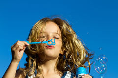 stock image of  girl blowing bubbles