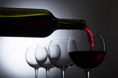 stock image of  glass and bottle of red wine.