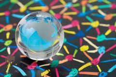 stock image of  globalization, social network or connectivity world concept, small decoration globe with colorful pastel link and connect chalk l