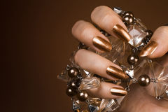 stock image of  glossy brown nails