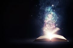 stock image of  glowing book with colors