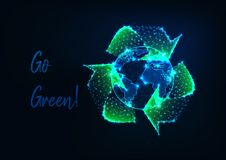 stock image of  glowing low polygonal earth globe and green recycle sign and text message go green on dark blue.