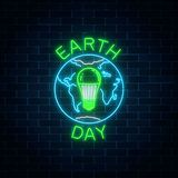 stock image of  glowing neon sign of world earth day with globe symbol and green led light bulb inside.