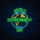 stock image of  glowing neon sign of world environment day with globe symbol and greeting text. earth day neon banner