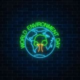 stock image of  glowing neon sign of world environment day with tree symbol in globe. earth day neon banner.