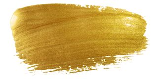 stock image of  gold color paint brush stroke. big golden smear stain background on white backdrop. abstract detailed gold glittering textured wet