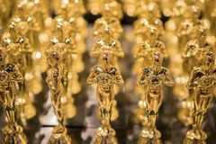 stock image of  golden awards in  a row