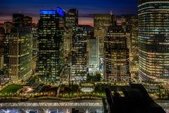 stock image of  golden lights of the san francisco skyline and salesforce transit center park