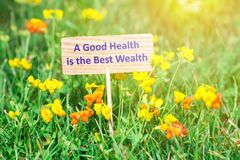stock image of  a good health is the best wealth signboard