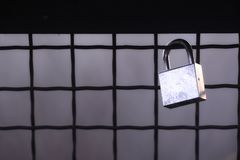 stock image of  black and white, steel cold padlock