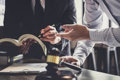 stock image of  good service cooperation, consultation of businessman and male lawyer or judge counselor having team meeting with client, law and