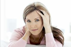 stock image of  gorgeous middle aged woman lying down looking at camera - portrait