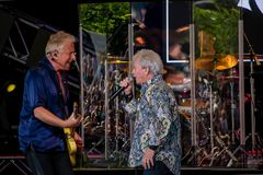 stock image of  graham rusell and russell hitchcock  from air supply, singing beautiful melody at epcot in walt disney world  5