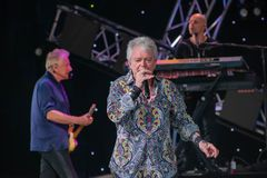 stock image of  graham rusell and russell hitchcock  from air supply, singing beautiful melody at epcot in walt disney world  1