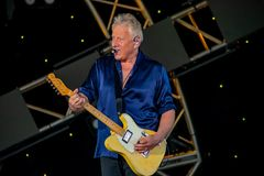 stock image of  graham russell   from air supply, singing beautiful melody at epcot in walt disney world 8