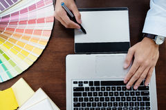 stock image of  graphic design and color swatches and pens on a desk. architectu