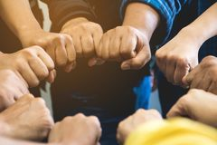 stock image of  group of business team work joining hand together