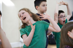 stock image of  group of children enjoying drama class together