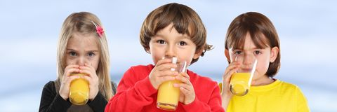 stock image of  group of children girl boy kids drinking orange juice healthy eating banner