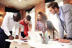 stock image of  group of five creative worker brainstorm together in office, new style of workspace, happy scene of people in office