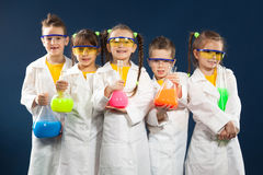 stock image of  group happy kids doing science experiments in the laboratory.