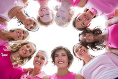 stock image of  group of happy women in circle wearing pink for breast cancer