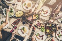stock image of  group of people having meal togetherness dining