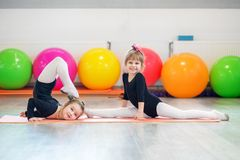 stock image of  group preschoolers learn gymnastics. the concept of sport, education, childhood, hobbies and dance