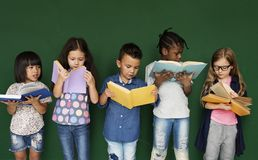 stock image of  group of school kids reading for education