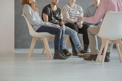 stock image of  group therapy for teenagers