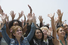 stock image of  group of women raising hands